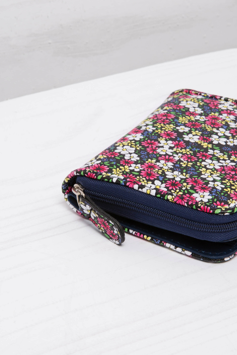 Floral wallet with zipper and button. image number null