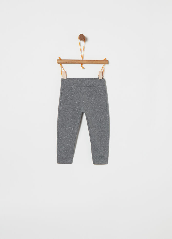Stretch trousers with glitter pattern