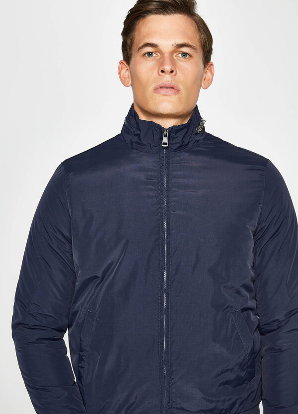 Jacket with pull-out hood