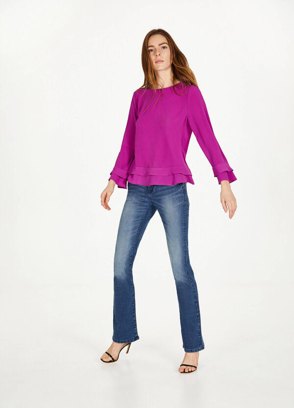 Blusa stretch con volant