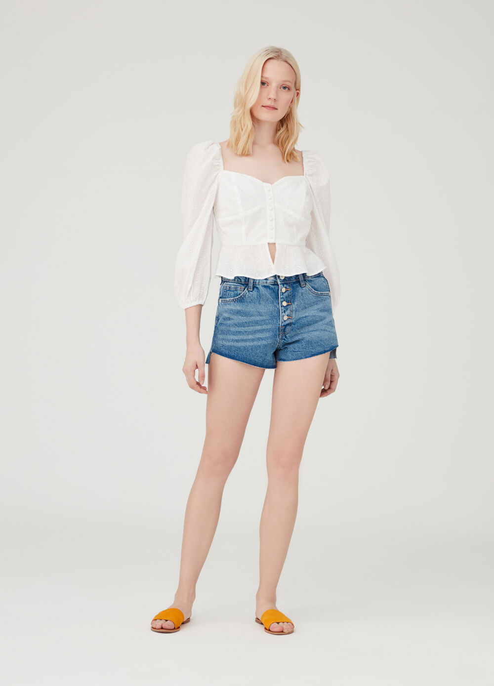 Faded denim shorts with high waist and pockets