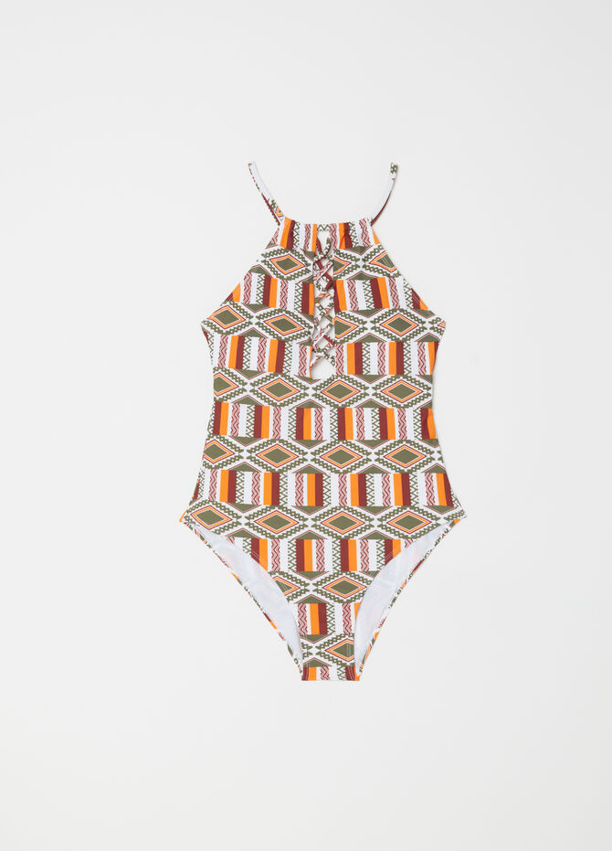 One-piece swimsuit with patterned openings