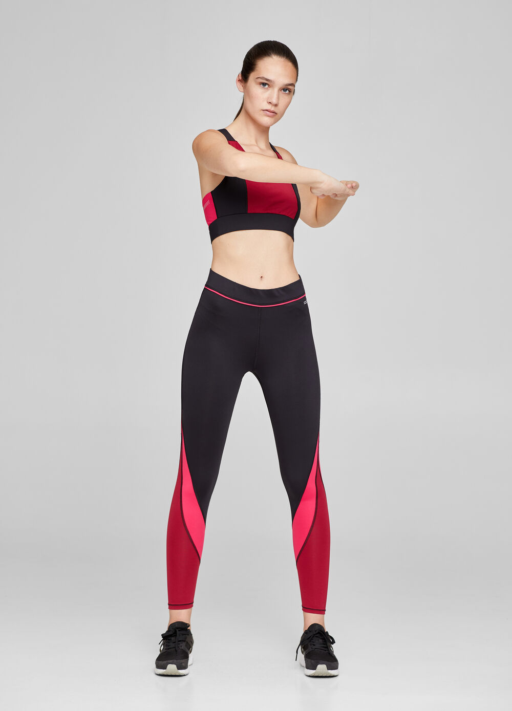 Top sportivo stretch bicolore