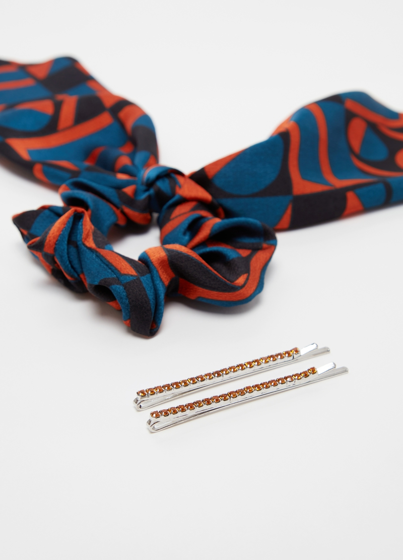 Set of two hairpins and one hair elastic image number null
