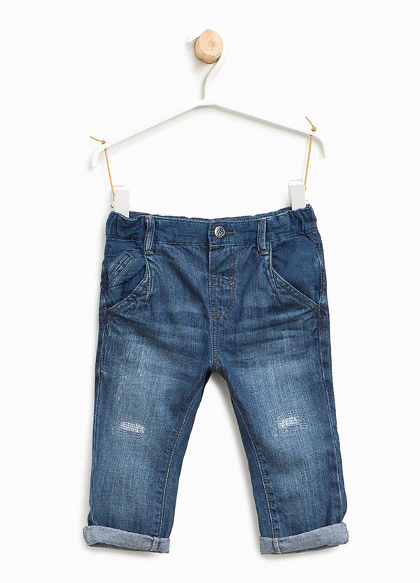 Worn-effects jeans with abrasions | OVS