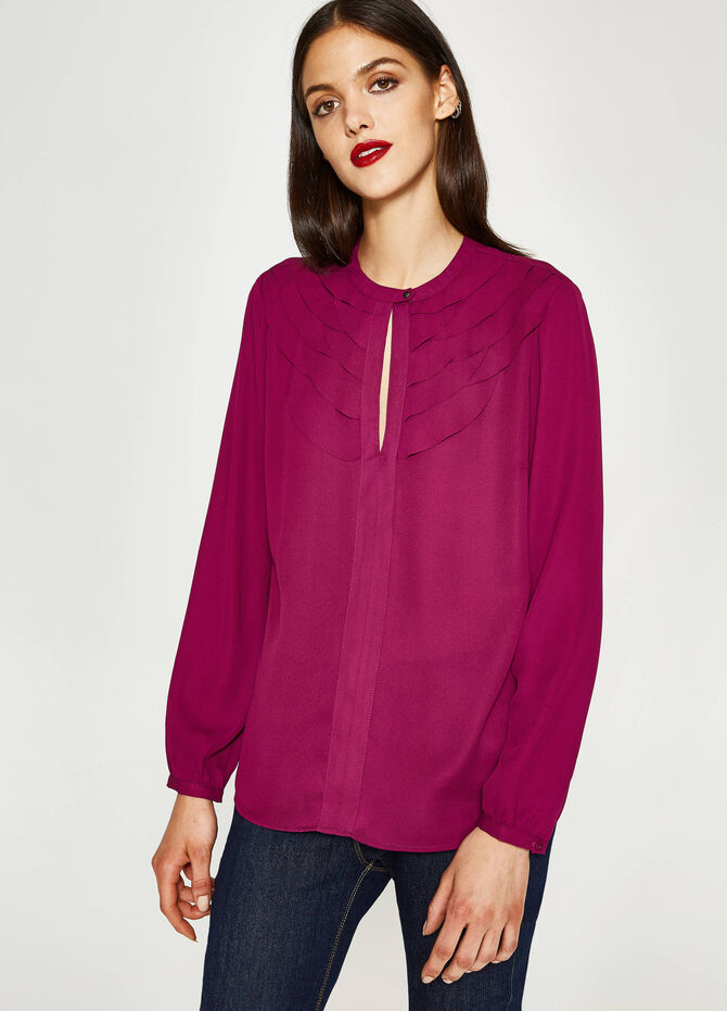 Blouse with opening and flounce