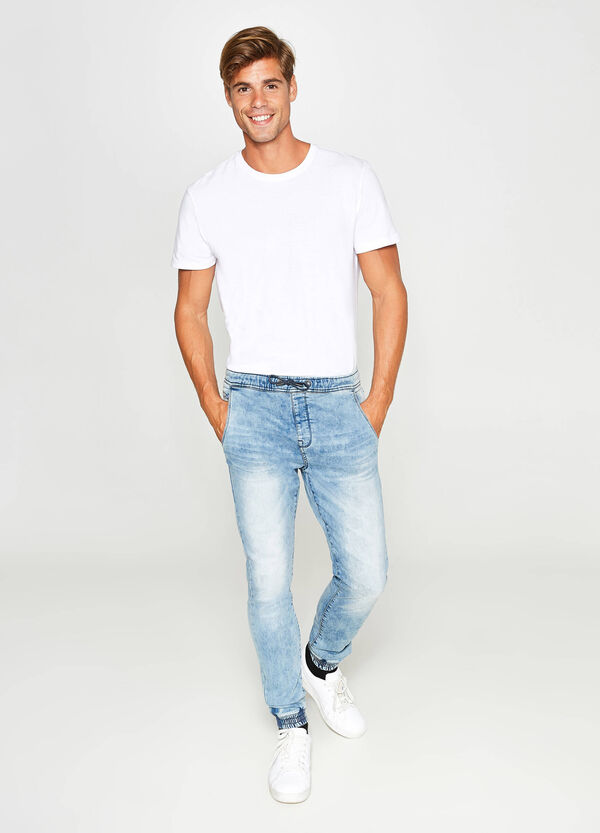 Jeans loose fit maltinti con scoloriture