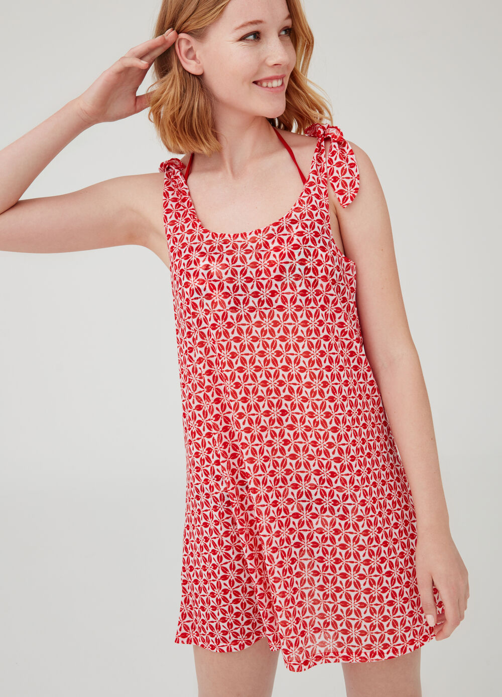 Sleeveless beach cover-up with cherry pattern