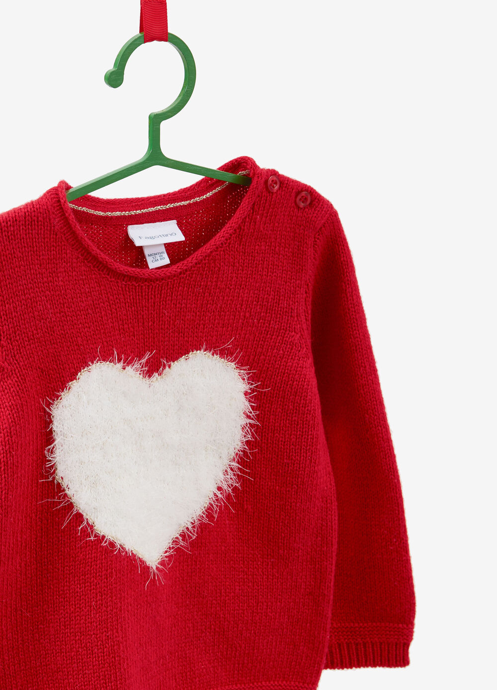 Knitted pullover with frayed heart patch