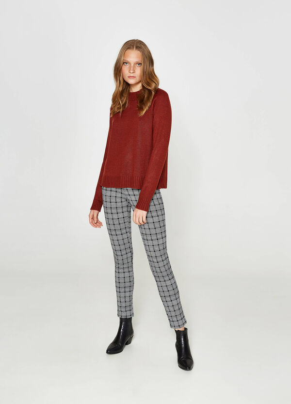 Knitted pullover with slits