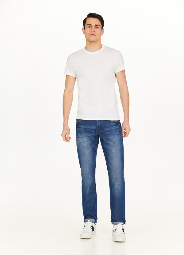 Worn-effect jeans with fading