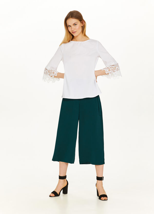 Stretch blouse with embroidery on the sleeves