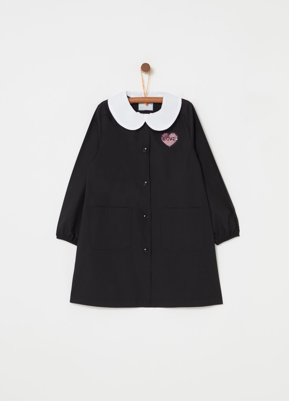 Smock with collar and heart patch