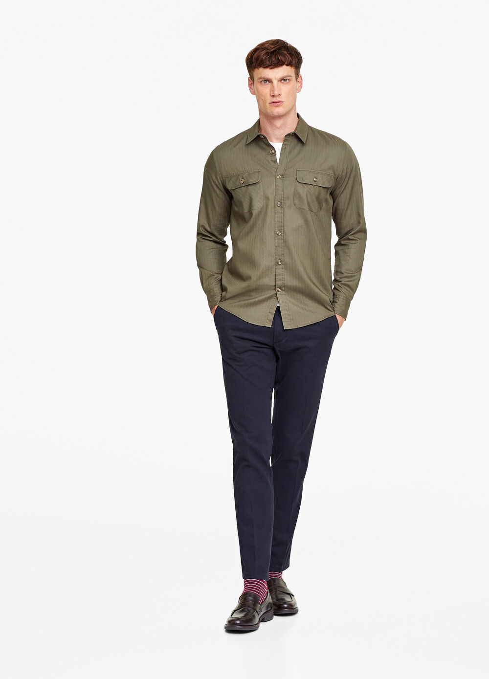 Shirt with solid colour pockets