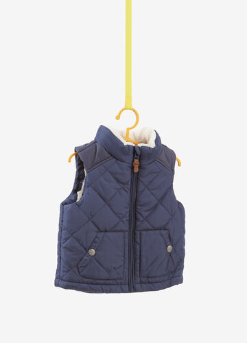 Padded gilet with faux fur