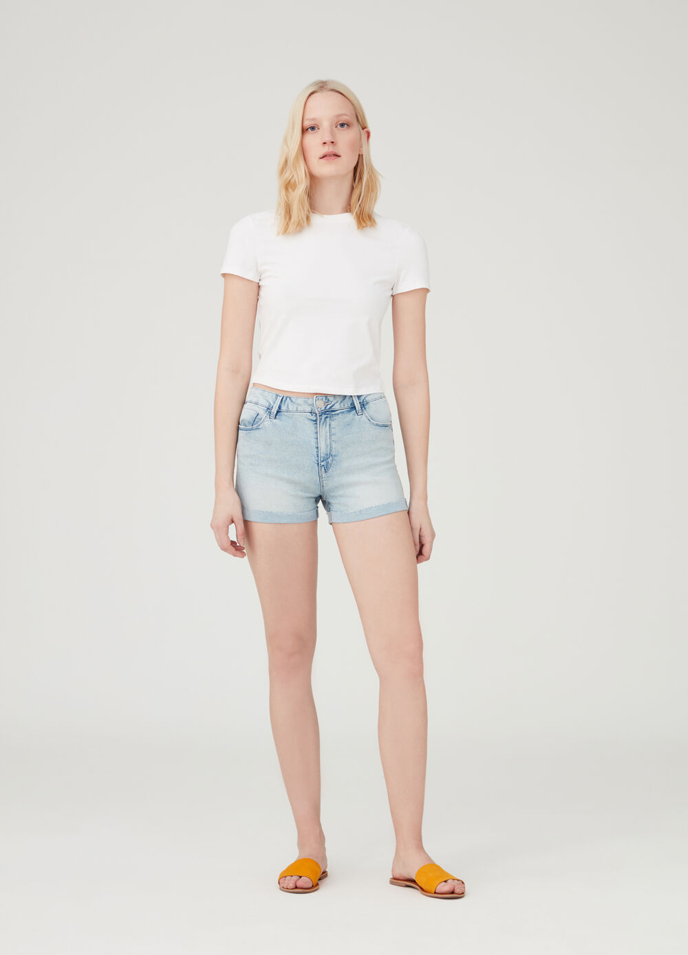 Stretch denim shorts with faded pockets