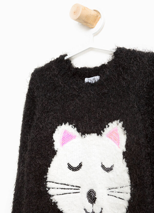 Frayed pullover with sequins and embroidery