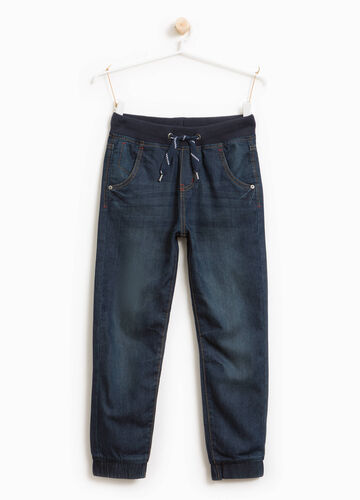Worn-effect jeans with drawstring