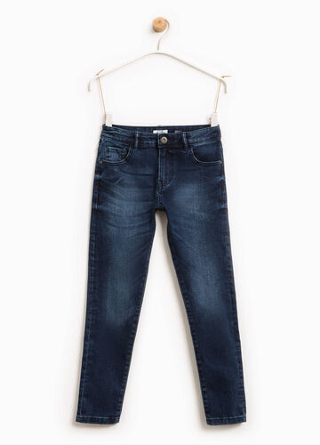 Worn-effect stretch jeans with whiskering