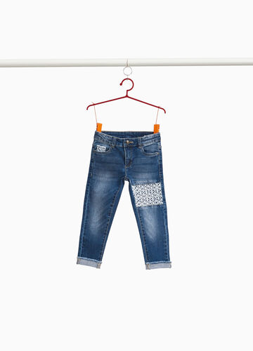 Washed-effect stretch jeans with inserts