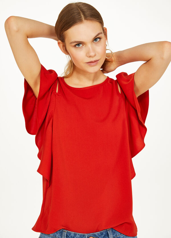 Solid colour blouse with openings and flounce