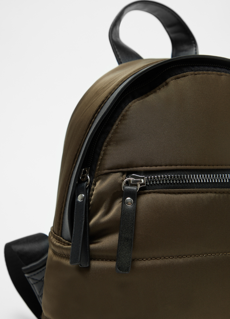 Solid colour padded and quilted backpack image number null