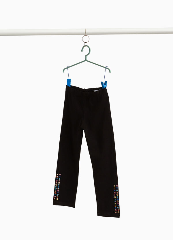 Three-quarter leggings with studs and eyelets