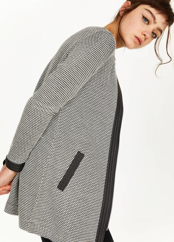 Knitted coat with shiny inserts
