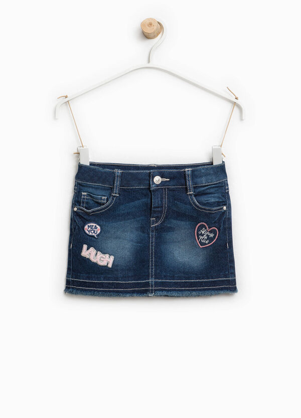 Worn denim skirt with patches | OVS