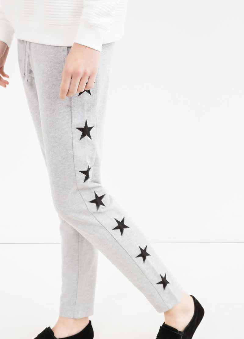 Joggers with stars patches image number null